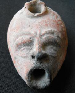 ancient-roman-oil-lamp-in-shape-of-an-actors-mask-anonymous-ceramic-artist